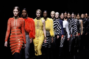 Models wear creations for Balmain's ready-to-wear fall/winter 2014-2015 fashion collection, presented in Paris, Thursday, Feb.27, 2014. (AP Photo/Thibault Camus)
