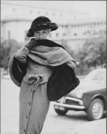 A model wearing a 1914 style suit: grey wool dress qand shawl with fur lining, moleskin hat and muff by the fashion house Balmain established by French fashion designer Pierre Balmain. 1956. (Photo by Mondadori Portfolio via Getty Images)